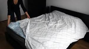 begin by turning your entire duvet cover inside out laying it flat against the bed or your floor if that s an easier space to work upon