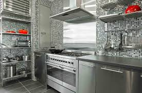 appealing stainless steel kitchen cabinet with red accent and mosaic wall tiles