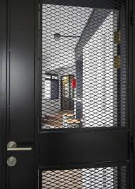 black metal screen doors. This Gate Has An Oblong Panel That Is Positioned In The Middle Of Expanded Metal Black Screen Doors