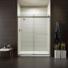 frameless sliding shower door in matte nickel with