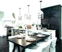 pendant lighting over kitchen peninsula above table