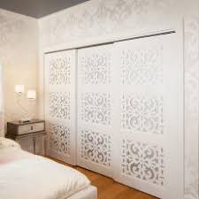 Chic White Bedroom With Patterned Closet Doors