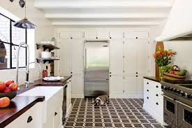 these chain pattern encaustic tiles add interest to this more classic farmhouse style kitchen