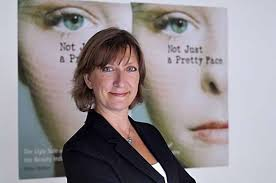 author stacy malkan in fron of her new book not just a pretty face