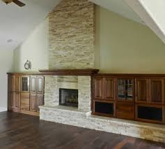 stone fireplace with built ins traditional family room