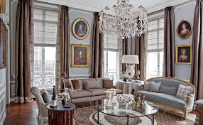 creative design of paris themed living room that decorated with victorian wall picture and beige long curtain also stunning chandelier light suspeded above