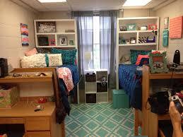 samford dorm room shelves above bed
