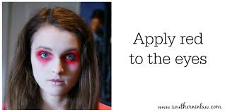 apply red to the eyes zombie makeup tutorial face painting step