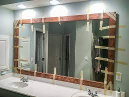 How To Diy Upgrade Your Bathroom Mirror With A Stained Wood Frame Building Our Rez