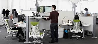 standing office table. The Sit-to-Stand Invasion Standing Office Table