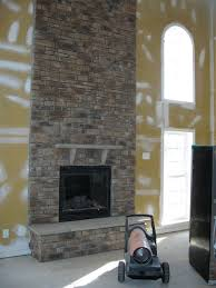 placing an lcd tv above a stone faced fireplace