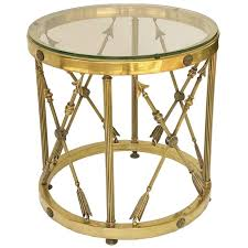 english round occasional table of brass and glass