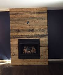 how to create a diy reclaimed wood fireplace surround for less than 100