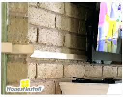 how to hide tv wires over brick fireplace on
