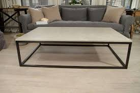 seagrass stone top coffee table on blackened metal base at marble and black metal coffee table