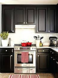 black and white cabinets black white and hints of red black cabinets white marble countertops