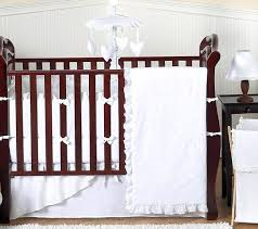brown and white crib bedding