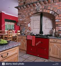 red country kitchens. Interesting Country Exposed Brick Wall And Ceramic Tiles Above Red Aga Oven In Large  Country Kitchen Intended Red Country Kitchens
