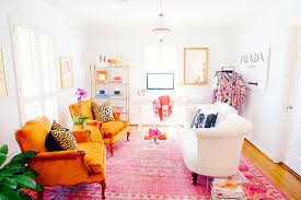 gold and orange and pink and white living room