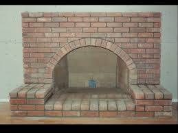 brick fireplace with arch and raised hearth