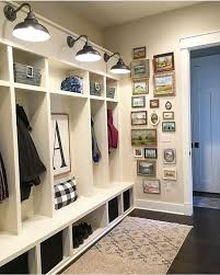 farmhouse mudroom with built in lockers barn light wall sconces a gallery wall