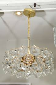 elegant chandelier with geometric crystals three tier and glamorous mid century design