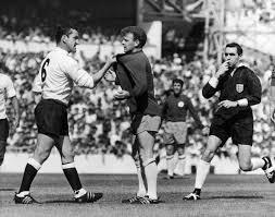 England: Soccer, 1966. /Ndave Mckay (Left) Of Tottenham Hotspur Confronts  Billy Bremner Of Leeds United During A Game, 22 August 1966. Referee Norman  Burtenshaw Blows His Whistle To Intervene. Poster Print by