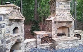 outdoor brick fireplace with grill oven