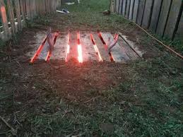A pallet, red light, fake hands, and a little digging make for a very  interesting Halloween yard decoration!