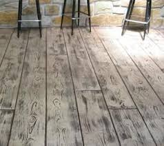 Concrete stamped to look like wood makes a beautiful patio or porch.