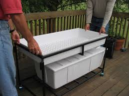 set flood and drain tray on top of upper platform