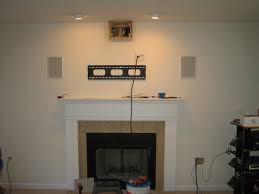 how to hide wires for wall mounted tv over fireplace uk