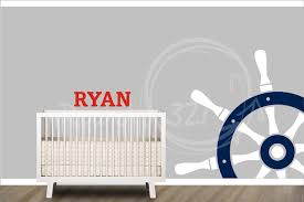 delightful coastal baby nursery room decoration using light grey baby room wall paint along with nautical themed home decor and boat steer baby room wall