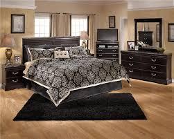 bedroom furniture in black. Elegant Sweet Black Bedroom Furniture Set Combined With Big Bed Attractive Floral Bedcover In