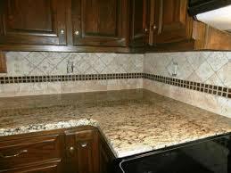 Superb ST. CECILIA Granite On Dark Cabinets Traditional Kitchen