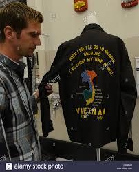 Kris Hickok A Museum Technician Shows A Souvenir Jacket Owned By
