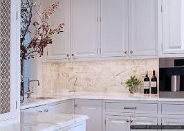 white marble tile kitchen.  Tile Marble Subway Tile Backsplash With White Kitchen Cabinet And Washing