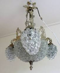 a venetian chandelier with hand blown murano glass lamp shades
