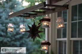 hang mason jar lights on ladder as a cute vintage lantern hanger adore diy hanging mason jar