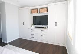 a wall of master bedroom built ins elevates this entire space and provides storage