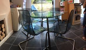 round glass dining table and 4 chairs ikea salmi table and tobias chairs