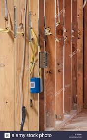 many electrical wires running through wall studs and connecting to many electrical wires running through wall studs and connecting to a metal outlet box at residential