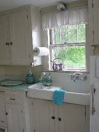 flour sack towels as window curtains it is a little hard to see