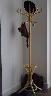 a wooden coat stand coat rack coat hanger argos home