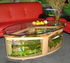 desk fish tank office aquarium aquariums furniture manufacturers table design that has an oval shape with a frame made of wood and glass around the