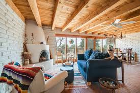 Living Room With Exposed Beam Ceiling Fan In Santa Fe Nm