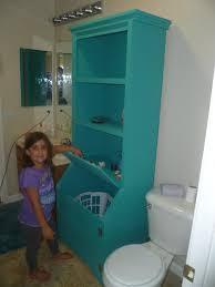 bathroom armoire with laundry hamper