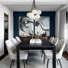 exle of a small trendy dark wood floor enclosed dining room design in new york with