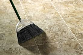 sweeping up vinyl flooring with a travertine look