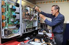 tv repair shop. howard sturges works to repair a 50-inch plasma television in his shop on tv